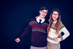 Composite image of happy geeky hipster couple embracing Royalty Free Stock Image