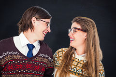 Composite image of happy geeky hipster couple looking at each other Royalty Free Stock Image