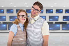 Composite image of happy geeky hipster couple with silly faces Royalty Free Stock Images