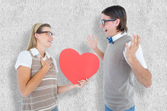 A Composite image of happy geeky hipster and her boyfriend Royalty Free Stock Photography