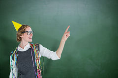 Composite image of happy geeky hipster pointing something Royalty Free Stock Images