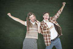 A Composite image of happy geeky hipsters singing with microphone Stock Photography
