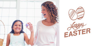 Composite image of happy girl holding easter egg Royalty Free Stock Image