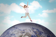 Composite image of happy girl jumping Royalty Free Stock Photo