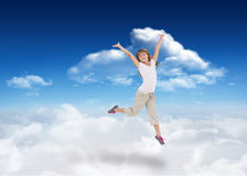 Composite image of happy girl jumping Stock Images