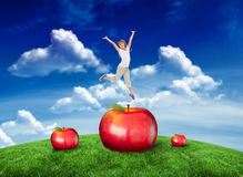 Composite image of happy girl jumping Stock Photo