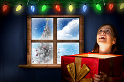 Composite image of happy girl opening gift box Stock Images