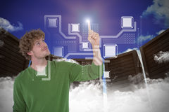 Composite image of happy handsome man pointing something Stock Photo