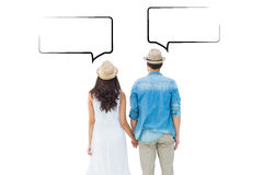 Composite image of happy hipster couple holding hands Stock Image