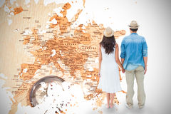 Composite image of happy hipster couple holding hands Royalty Free Stock Photography