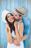 Composite image of happy hipster couple hugging and smiling Stock Images