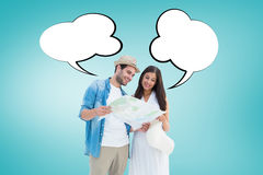 Composite image of happy hipster couple looking at map Royalty Free Stock Photos