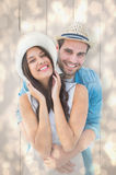 Composite image of happy hipster couple smiling at camera Royalty Free Stock Images
