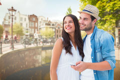 Composite image of happy hipster couple smiling together Royalty Free Stock Photography