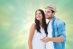 Composite image of happy hipster couple smiling together Royalty Free Stock Photo