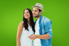 Composite image of happy hipster couple smiling together Stock Image