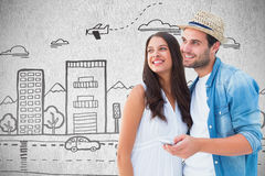 Composite image of happy hipster couple smiling together Royalty Free Stock Image