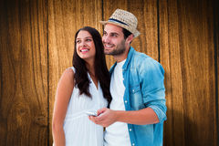Composite image of happy hipster couple smiling together Royalty Free Stock Images
