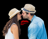 Composite image of happy hipster couple about to kiss Royalty Free Stock Photo