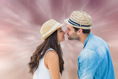 Composite image of happy hipster couple about to kiss Stock Photos