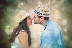 Composite image of happy hipster couple about to kiss Royalty Free Stock Photography