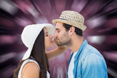 Composite image of happy hipster couple about to kiss Stock Image