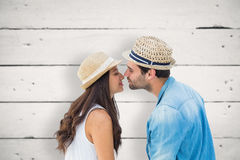 Composite image of happy hipster couple about to kiss Stock Photography