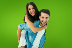 Composite image of happy hipster giving his girlfriend a piggy back Stock Photography