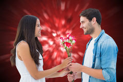Composite image of happy hipster giving his girlfriend roses Royalty Free Stock Images