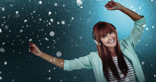 Composite image of happy hipster woman listening music with headphone Stock Photo