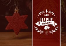 Composite image of happy holidays wishes with christmas star decoration Royalty Free Stock Photos