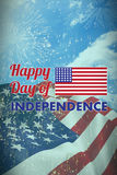 Composite image of happy independence day text with american flag. Happy independence day text with American flag against colourful fireworks exploding on black Royalty Free Stock Image