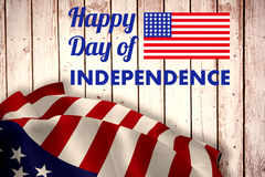 Composite image of happy independence day text with american flag Stock Photo
