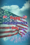 Composite image of happy independence day text with american flags Stock Images