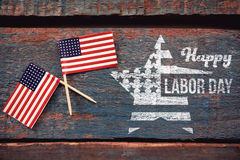 Composite image of composite image of happy labor day text and star shape american flag Stock Image