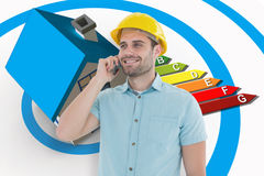 Composite image of happy male architect conversing on mobile phone. Happy male architect conversing on mobile phone against energy ratings chart coming from 3d Stock Image