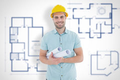 Composite image of happy male architect holding blueprints. Happy male architect holding blueprints against blueprint Royalty Free Stock Image