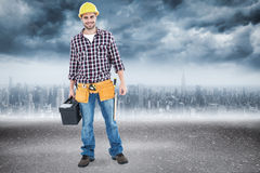Composite image of happy male hanyman carrying toolbox Stock Photos