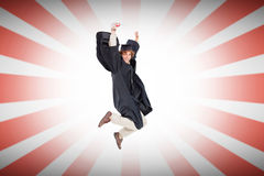 Composite image of happy male student in graduate robe jumping Royalty Free Stock Photography