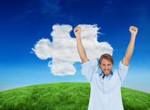 Composite image of happy man celebrating success with arms up Royalty Free Stock Photography
