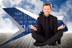 Composite image of happy man doing yoga exercises Royalty Free Stock Image