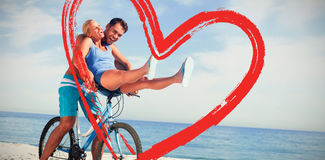 Composite image of happy man giving girlfriend a lift on his crossbar Stock Photos
