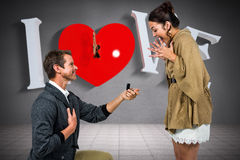 Composite image of happy man offering engagement ring to partner Royalty Free Stock Photography