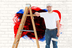 Composite image of happy man with paint roller standing by ladder Stock Photo