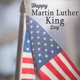 Composite image of happy martin luther king day. Happy Martin Luther King day against american flag waving in restaurant stock image