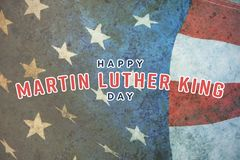 Composite image of happy martin luther king day. Happy Martin Luther King day against american flag on a wooden table stock photos