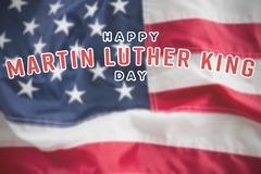 Composite image of happy martin luther king day. Happy Martin Luther King day against full frame of wrinkled american flag royalty free stock photography