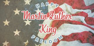 Composite image of happy martin luther king freedom. Happy Martin Luther King freedom against american flag on a wooden table royalty free stock images