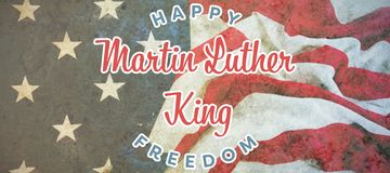 Composite image of happy martin luther king freedom. Happy Martin Luther King freedom against american flag on a wooden table royalty free stock photo
