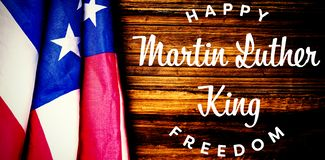 Composite image of happy martin luther king freedom. Happy Martin Luther King freedom against usa flag on table stock photo